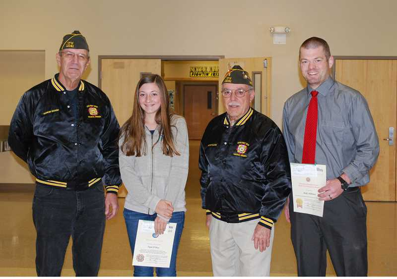 SUBMITTED PHOTO - Pictured from left, VFW Quartermaster Richard Lohman, student Tegan Macy, VFW Commander Leonard Hellwig and Culver teacher Mark Habliston.