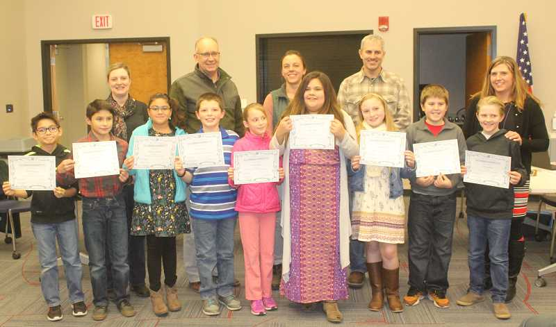 SUSAN MATHENY/MADRAS PIONEER - 509-J Board members Courtney Snead, back left, Stan Sullivan, Jamie Hurd, and Tom Norton Jr., with Buff Principal Billie Jo White, congratulate students Michael Young, left, Robert Soliz, Maya Garcia, Hunter Denny, Autumn Keever, Dulce Orozco, Gracie Otter, Kyler Stein and Killian White.