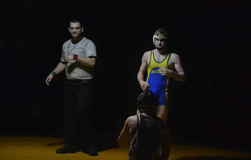 TIMES PHOTO: MATT SINGLEDECKER - Aloha 145-pound wrestler Payton Volk was one of the Warriors to win his match against Century last week.