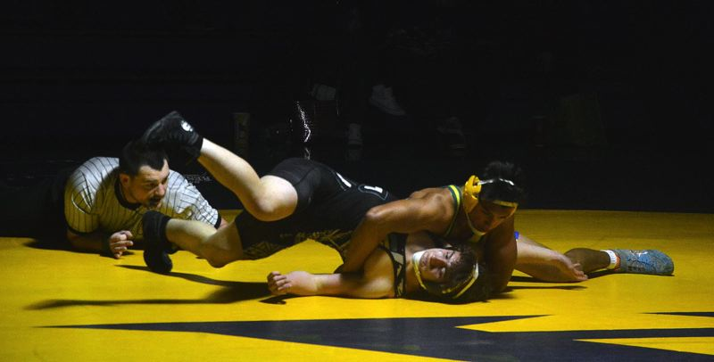TIMES PHOTO: MATT SINGLEDECKER - Aloha 152-pound Ismael Garcia won his match by major decision against Century last week at Aloha High School.
