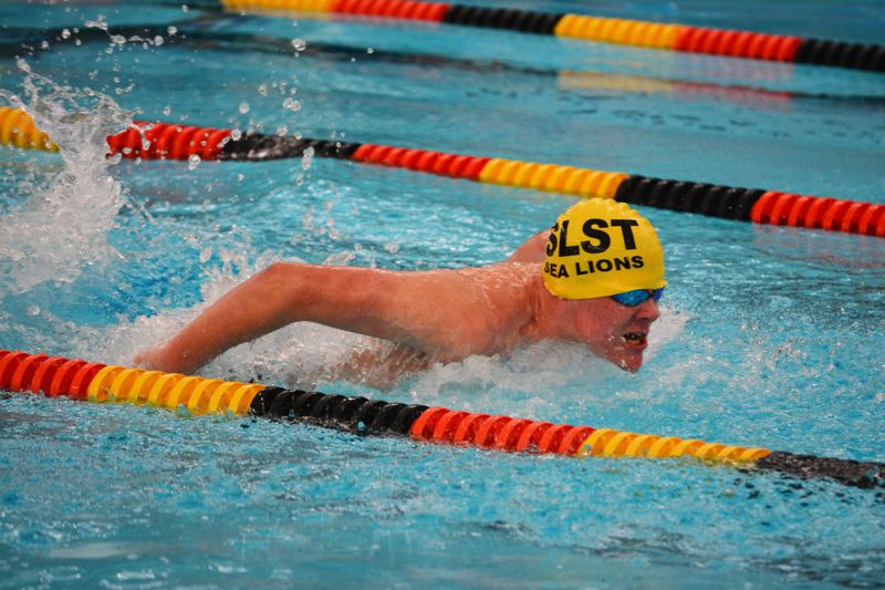 SPOTLIGHT PHOTO: JAKE MCNEAL - Lions freshman Ryan Maher swims the butterfly against La Salle Prep Thursday, Jan. 4, at Eisenschmidt Pool in St. Helens.