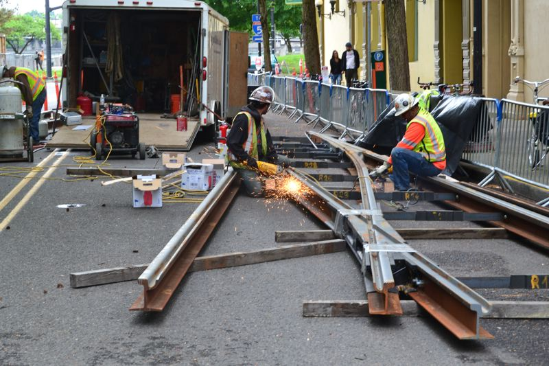 PAMPLIN MEDIA GROUP: FILE PHOTO - TriMet ironworkers fix a rail on a MAX transportation infrastructure project in downtown Portland.