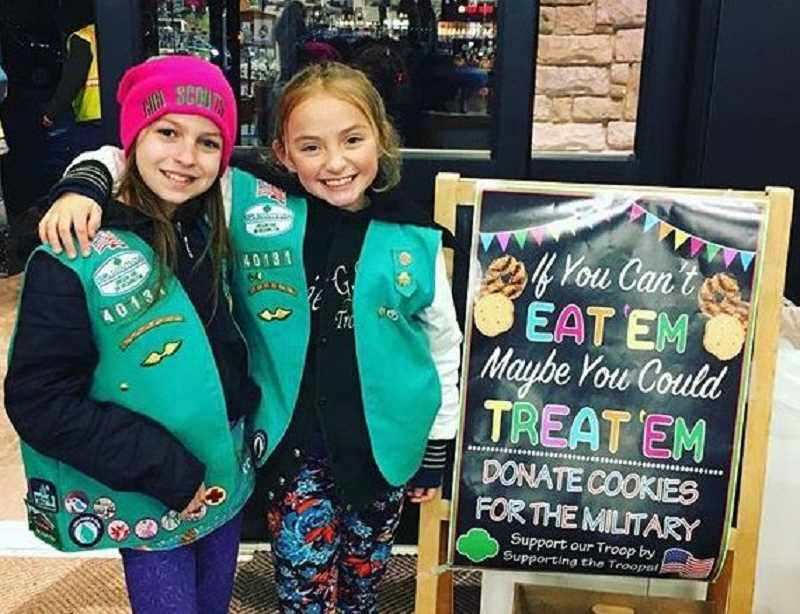 SUBMITTED PHOTO: MEGAN GABRIEL - Best friends Makayla McCartney-Pike (left) and Melanie Gabriel-Hastings hope to sell a lot of Girl Scout cookies in 2018, including some that will be sent to soldiers overseas.