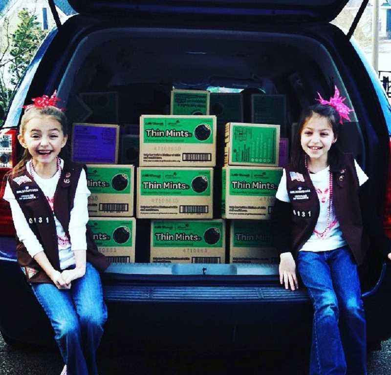 SUBMITTED PHOTO: MEGAN GABRIEL - Melanie Gabriel-Hastings (left) and Makayla McCartney-Pike have been selling Girl Scout cookies together ever since they were Brownies. 'One of my favorite parts of selling cookies is hanging out with my best friend,' Melanie says.