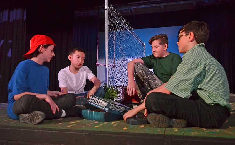 REVIEW PHOTO: VERN UYETAKE - From left: Corky (Michael Czar), Jeremy (Darren Sze), Brock (Aiden Fuller) and Joel (Dex Ertell) try to settle a dispute with a game of Battleship during a dress rehearsal this week for Lakeridge Junior High School's production of 'A Tree With Arms.'