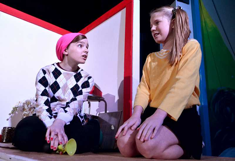 REVIEW PHOTO: VERN UYETAKE - Lindsey (Honor Joslin, left) and Katie (Charlotte Thompson) try to resolve a conflict in Lakeridge Junior High School's production of 'A Tree With Arms.' The play deals with issues of petty jealousy, willful ignorance, peer pressure and intolerance.