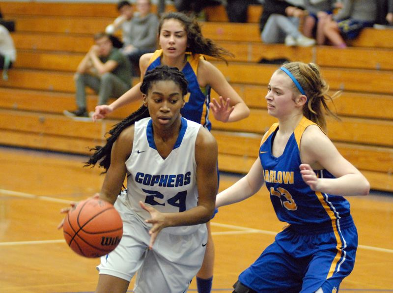 GRESHAM OUTLOOK: MATT RAWLINGS - Gresham's Destiny Ogebema drives to her right while being defended by Barlow's Kori Clark
