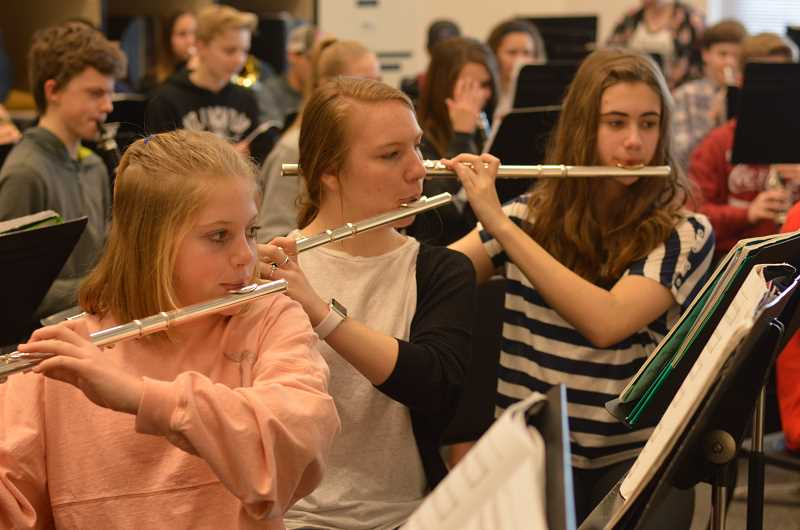 TIDINGS PHOTO: CLARA HOWELL  - Eighth-graders Lila Skates (left), Jenna Goodheart (middle) and Ella Weeks (right) all play the flute for the concert band.