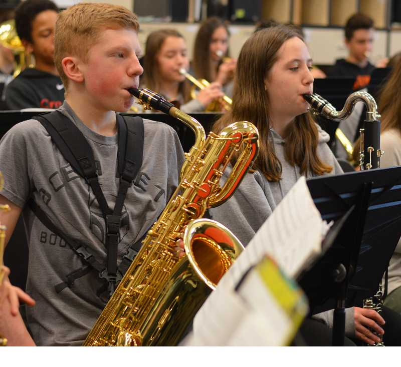 TIDINGS PHOTO: CLARA HOWELL  - Eighth-graders Ben McClelland (left) plays the baritone saxophone and Hannah Anderson (right) plays the bass clarinet during band practice.