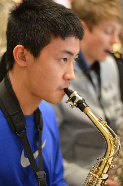 TIDINGS PHOTO: CLARA HOWELL  - Eighth-grader Steven Niu focuses on his alto saxophone.