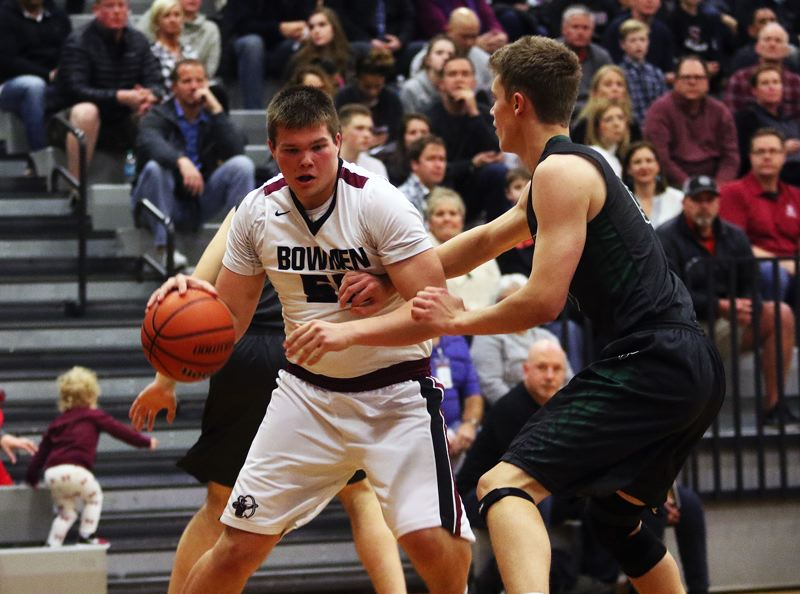 DAN BROOD - Sherwood senior Jace Sucher (left) looks to drive against Tigard senior Austin Dufort during Friday's game.
