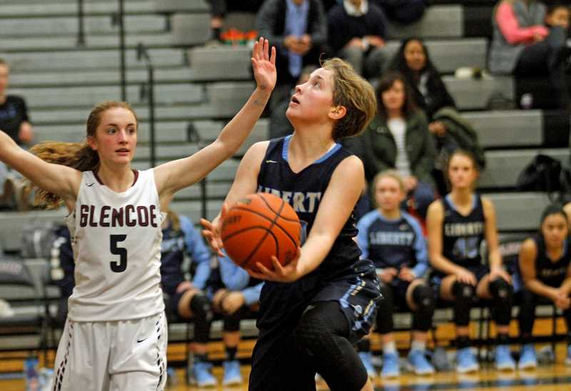 HILLSBORO TRIBUNE PHOTO: WADE EVANSON - Liberty's Livia Knapp follows a nice spin with a lay-in during the Falcons' game against Glencoe Jan. 10 at Glencoe High School.