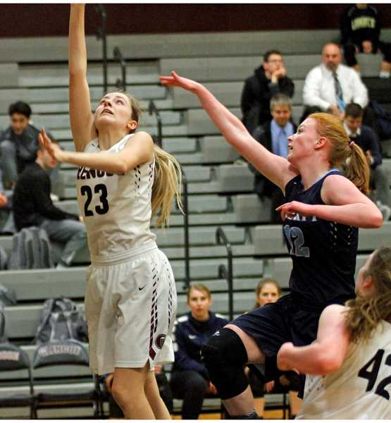 HILLSBORO TRIBUNE PHOTO: WADE EVANSON - Glencoe's Sydney Larrison goes up for a lay-in during the Tide's game against Liberty Jan. 10 at Glencoe High School.