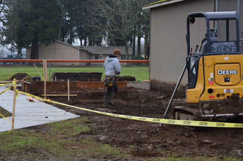 SPOTLIGHT PHOTO: NICOLE THILL - Colin Siemienczuk, of Double D Consulting Co., works at a construction site near the Scappoose varsity softball field on Tuesday, Jan. 9. Crews are working to build a new concession stand and restroom facility at the site.