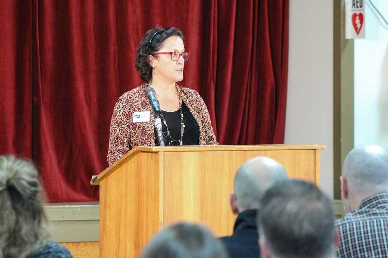 HILLSBORO TRIBUNE PHOTO: GEOFF PURSINGER - North Plains Mayor Teri Lenahan addresses a packed crowd at the Jessie Mays Community Hall Tuesday afternoon, Jan. 9.