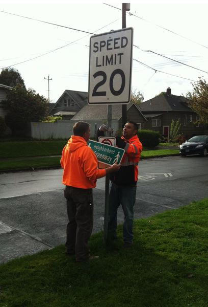 COURTESY PBOT - Portland Bureau of Transportation workers installing a new 20 mile per hour sign on a Neighborhood Greenway street.