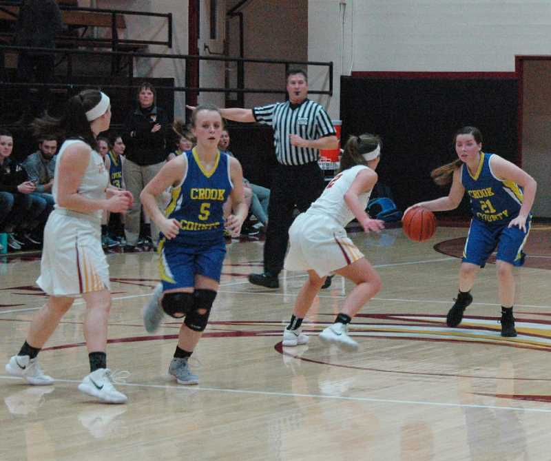 PHOTO COURTESY OF MIKE WEBER - Sarah Connolly attempts to bring the ball up the court against a full-court man-to-mad defense by The Dalles. The Riverhawks forced the Cowgirls into 46 turnovers as they raced to an easy 64-19 victory over Crook County.