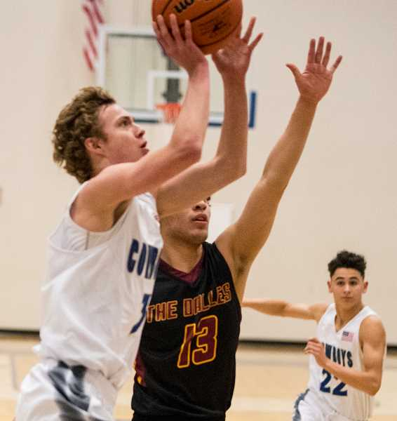 LON AUSTIN/CENTRAL OREGONIAN - Kaleb Savage goes to the hoop for two of his eight points during the Cowboys' Wednesday night loss to The Dalles Riverhawks. Crook County led much of the game before going cold in the fourth quarter of the 51-46 defeat.