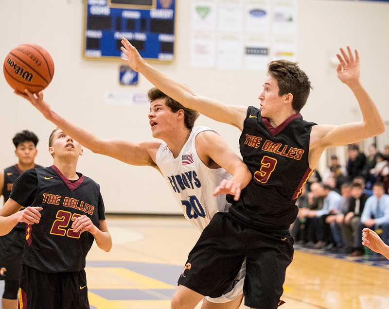 LON AUSTIN/CENTRAL OREGONIAN - Chase Bales throws up a shot as he is fouled under the bucket. Bales led the Cowboys in scoring with 13 but fouled out late in the game as The Dalles went on to win.