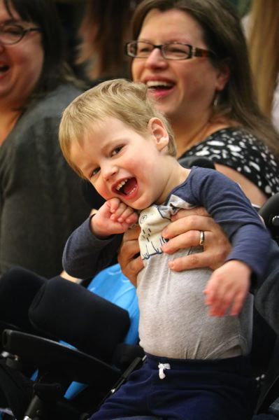 CONTIRBUTED PHOTO: REYNOLDS SCHOOL DISTRICT - Reynolds High Schools sparrow Juno and his mom Dawn get a kick out of the student enthusiasm at the recent assembly introducing Juno to