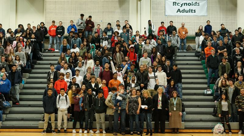 CONTRIBUTED PHOTO: SPARROW CLUBS, ROB MANDZIJ - Reynolds High School students stand at a recent assembly to show their support for the newest Raider, Juno.