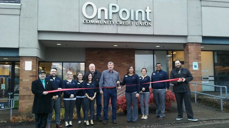 CONTRIBUTED PHOTO: DIANE CASTILLO-WHITE - OnPoint bank employees stand alongside Troutdale City Councilor Rich Allen (far left), Glenn White (center) and printer Matt Leamy (far right). West Columbia Gorge Chamber of Commerce President Glenn Mackey holds the scissors with branch manager Dara Toscano.