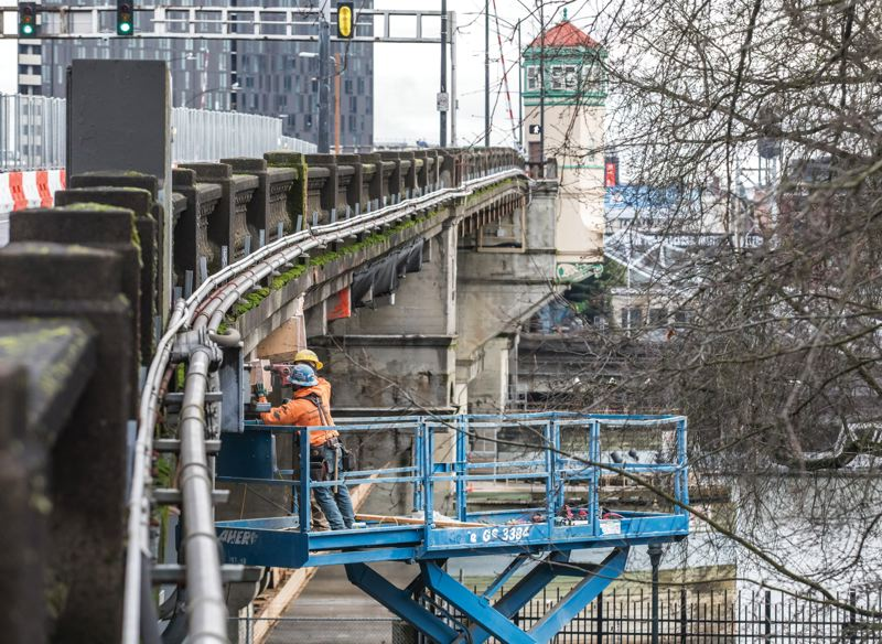 PAMPLIN MEDIA GROUP: JONATHAN HOUSE - Hamilton workers excavate crumbling concrete on the Burnside Bridge, through 2019.