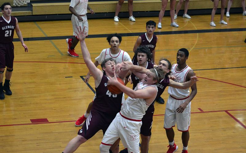 TIMES PHOTO: MATT SINGLEDECKER - The Glencoe and Westview boys basketball teams battle for a rebound on Friday at Westview High.