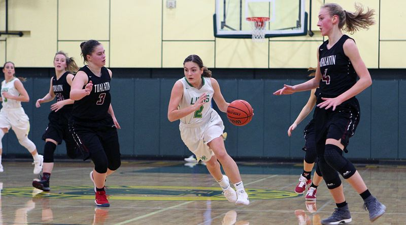 TIDINGS PHOTO: MILES VANCE - West Linn senior guard Kennedi Byram speeds upcourt during her team's 57-35 home win over Tualatin on Friday.