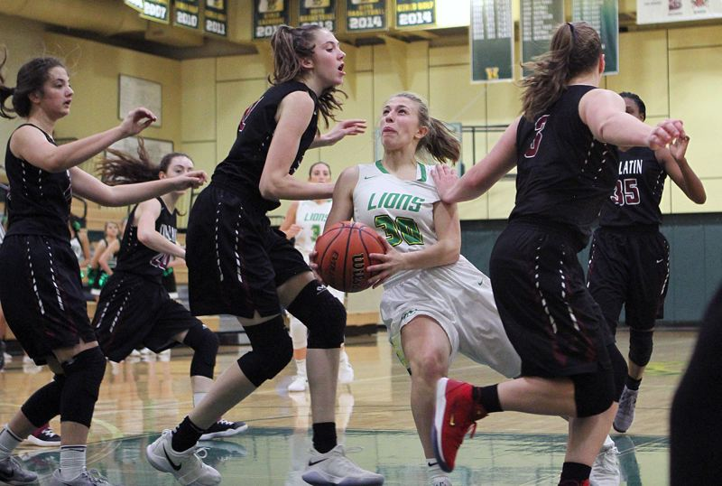TIDINGS PHOTO: MILES VANCE - West Linn freshman guard Cami Fulcher looks for room to score during her team's 57-35 home win over Tualatin on Friday night.