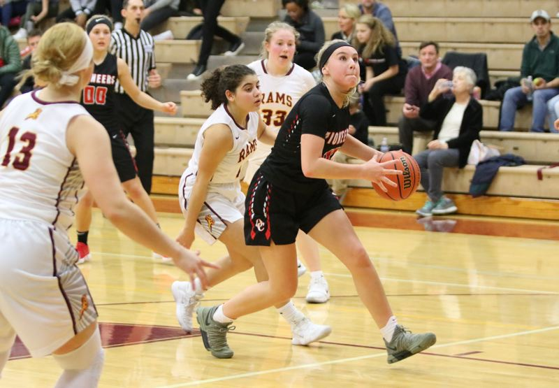 REVIEW/NEWS PHOTO: JIM BESEDA - Oregon City's Brooke Bullock drives to the basket for two of her 13 points in Friday's 58-45 Mt. Hood Conference girls' basketball road win over Central Catholic.
