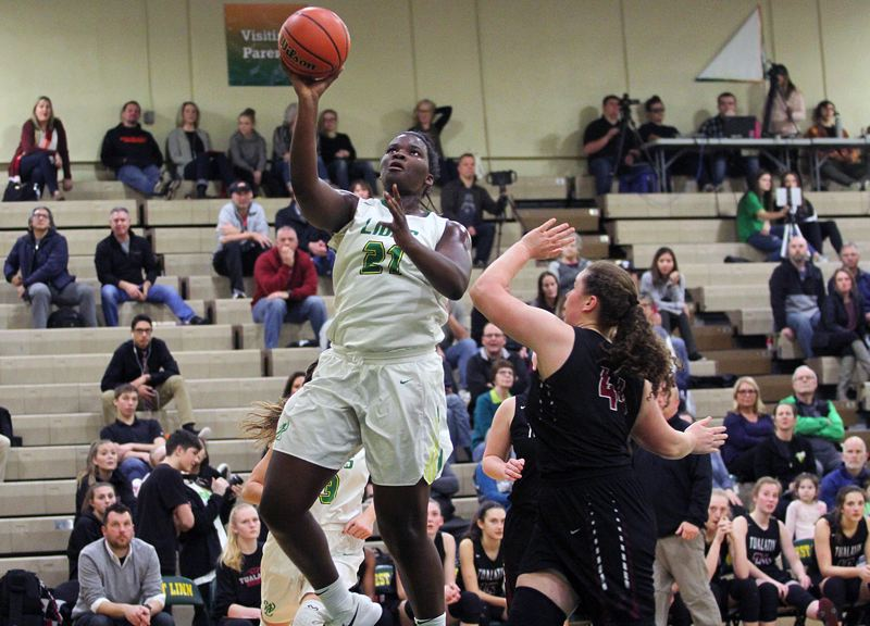 TIDINGS PHOTO: MILES VANCE - West Linn's Aaronette Vonleh goes up to score during her team's 57-35 home win over Tualatin on Friday.