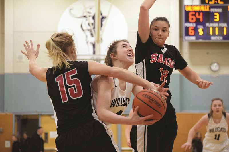SPOKESMAN PHOTO: TANNER RUSS - Junior Teagan McNamee was a workhorse for the Wildcats against the Sandy Pioneers on Jan. 12.