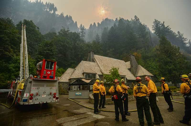 PAMPLIN MEDIA GROUP: JOSH KULLA - Only a massive fire fighting effort prevented the Multnomah Fall Lodge from being destroyed by the Eagle Creek fires.