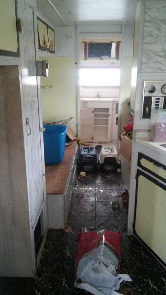 SUBMITTED PHOTO: PRAKOPIY CAM - Pictured is the inside of the trailer after Cam had hauled it from his property. The two cat kennels can be seen in the center.