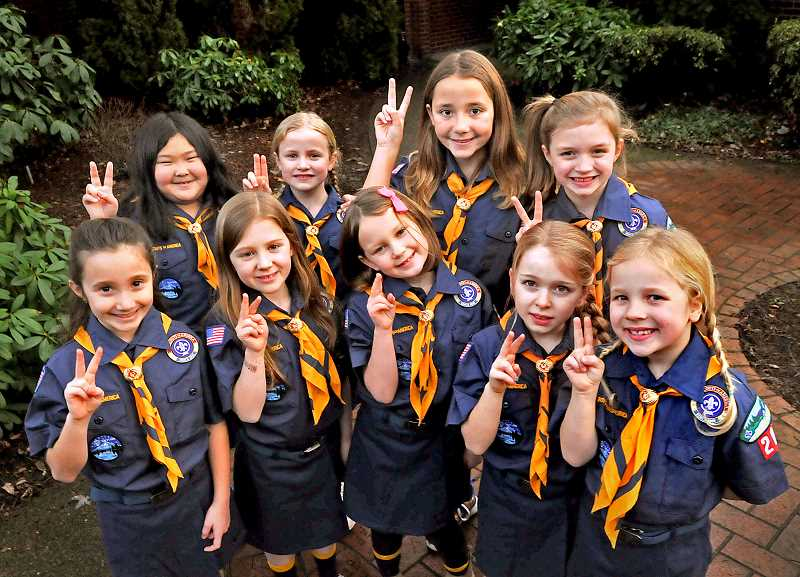 REVIEW PHOTO: VERN UYETAKE - As of Monday, these Lake Grove second-graders are officially Cub Scouts and members of Lake Oswego's Pack 203. Front row from left: Emma Leverton, Ella Wennerth,Tatum Moore, Sarah Firmin and Mia Jensen. Back row from left:Zoie Senzaki, Claire Brandt,Ellie Holverson and Emerson Lewis.