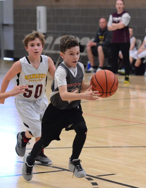 SANDY POST: DAVID BALL - Sandy point guard Kobe Sparks breaks down the lane on his way to a layup for two of his game-high 14 points Sunday during a 53-19 win over Milwaukie.