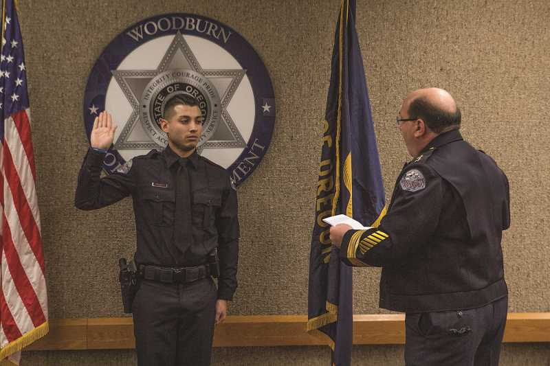 INDEPENDENT PHOTO: JULIA COMNES - Juan Morales is sworn in as the Woodburn Police Department's newest officer by Chief Jim Ferraris at Jan. 8's City Council meeting.
