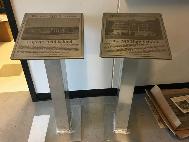 COURTESY PHOTO: AMBER MATHIESEN - The signs that will mark the Mount Angel Heritage Trail will have a similar design to the signs used for the Silverton Heritage Trail. Pictured are two of the Silverton signs.
