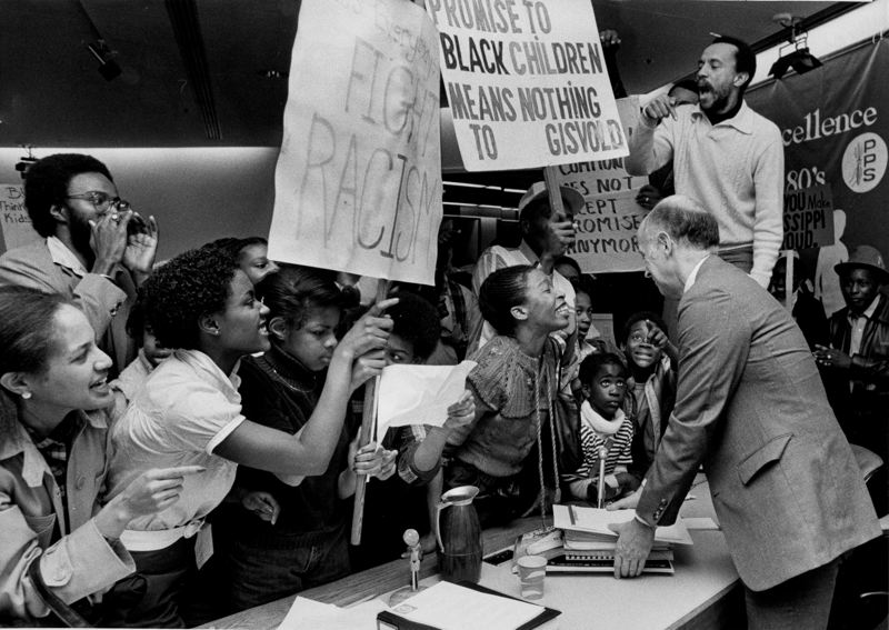 COURTESY PHOTO - Black United Front leader Ron Herndon stands on a desk at a school board protest against the closure of Harriet Tubman Middle School on March 30, 1982. Photographed by Steve Nehl, Oregon Historical Society Research Library, Oregon Journal Collection.