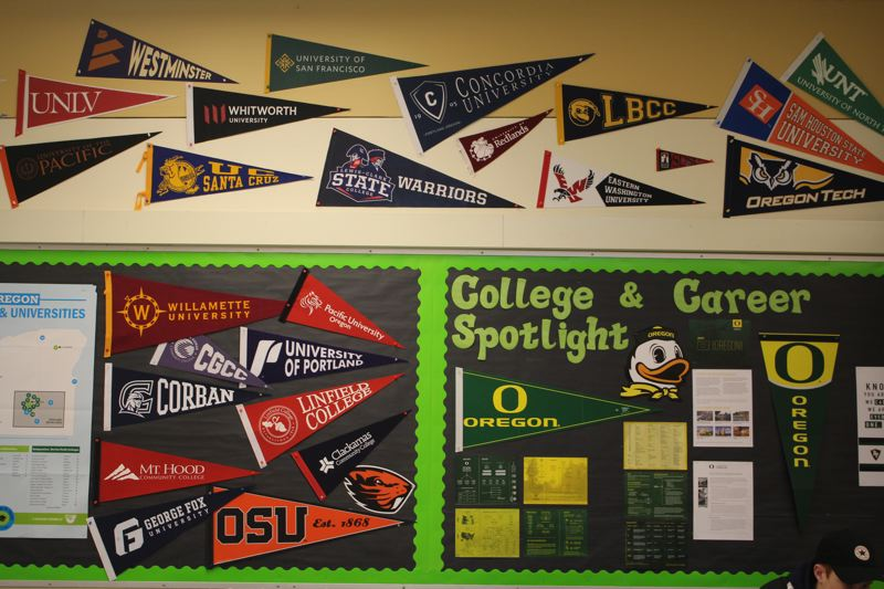PHOTO BY: MADISON DALLING-RAISNER - Posters from various colleges help decorate the College and Career Readiness classroom at Rex Putnam High School.