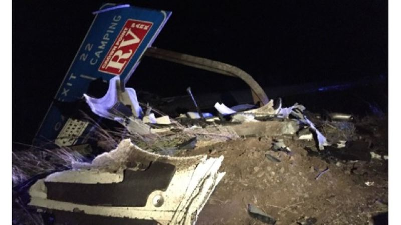 KOIN 6 NEWS PHOTO  - A sign for Exit 22 of Interstate 84 was mangled during the collision between a semi truck and parked Chevy Tahoe on Monday, Jan. 15.