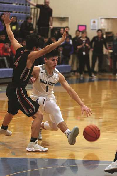 PHIL HAWKINS - Woodburn junior Trevor Karsseboom led the Bulldogs with 16 points against the No. 8 Central Panthers in the team's 46-44 loss on Friday.