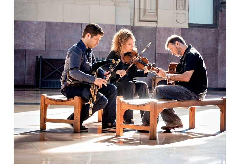 SUBMITTED PHOTO - Open the Door for Three is fiddle player Liz Knowles, uilleann piper Kieran OHare, and Dublin-born singer and bouzouki player Pat Broaders and will be playing Feb. 9.