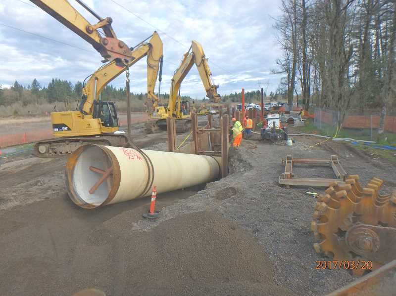 SUBMITTED PHOTO: CITY OF WILSONVILLE - Workers install pipe at the site of the Kinsman Road extension project.