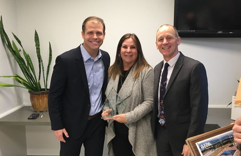 COURTESY PHOTO: CITY OF TROUTDALE - EPA Region 10 Division Director Sheryl Bilbrey, center, presented the Howard Orlean award to Troutdale Mayor Casey Ryan, left, and City Manager Ray Young on Thursday, Jan. 11.