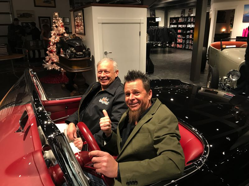 COURTESY PHOTO: JERRY GEISZLER - Jerry Geiszler, left, of Corvette Image in Gresham sits in the 1957 Corvette he helped Dave Kindig, right, and his family restore. Geiszler was featured in a recent episode of Kindigs Bitchin Rides TV series.