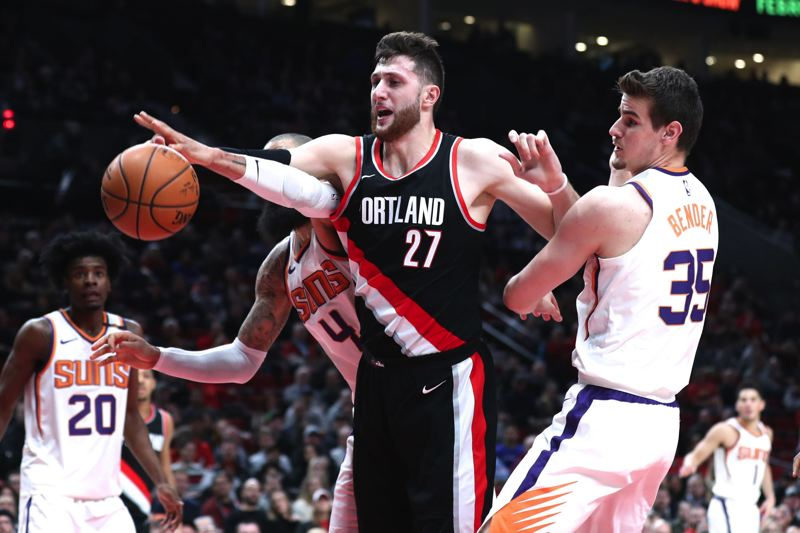 TRIBUNE PHOTO: JAIME VALDEZ - Jusuf Nurkic of the Trail Blazers fights for a rebound Tuesday night with Dragan Bender (right) and Tyson Chandler (4) of the Phoenix Suns.
