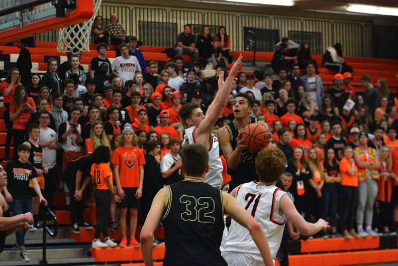 TIMES PHOTO: MATT SINGLEDECKER - Southridge senior shooting guard Bo Quinlan drives to the basket for two against Beaverton.