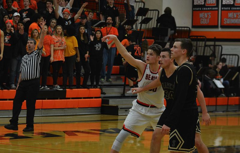 TIMES PHOTO: MATT SINGLEDECKER - Beaverton senior Jake Estep watches as a three-pointer heads toward  the rim against Southridge.